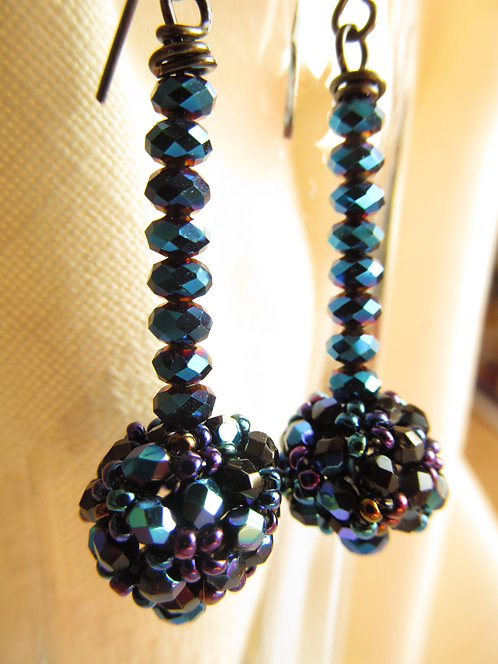 Handmade earrings of midnight blue glass on hematite