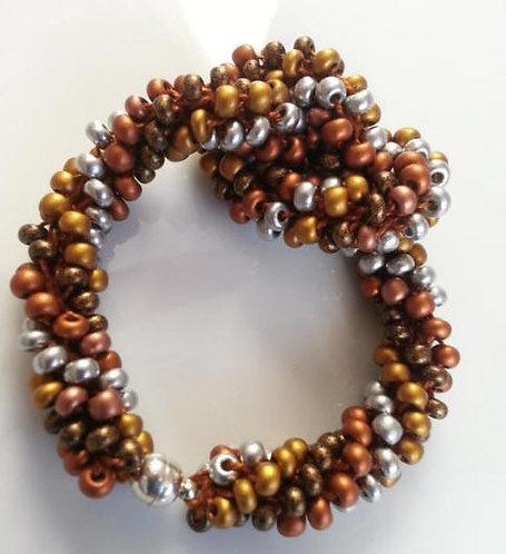 Handmade bracelet crochet spiral whirls of Southwestern mountain colors