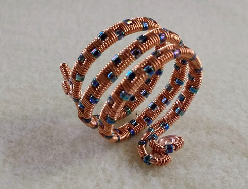 Handmade ring wire wrapped copper with iridescent blue glass