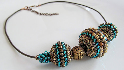 Handmade Necklace of hand beaded beads on dark brown leather cord