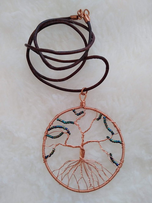 "copper 2.25"" pendant with metallic green beads on 22"" leather cord"
