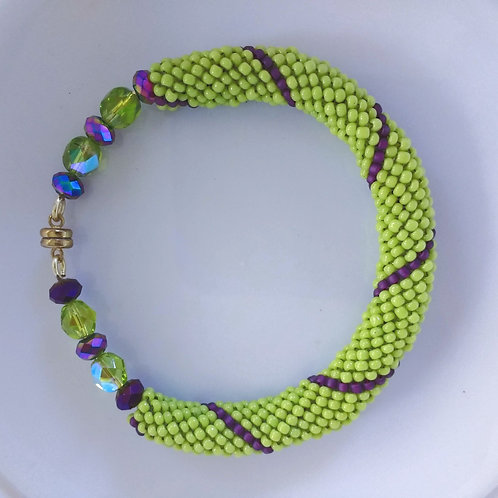 Handmade bracelet beaded in purple and lime glass with gold magnet