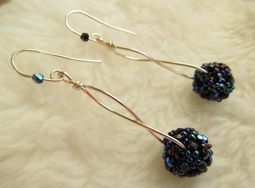 Handmade earrings of midnight blue glass on silver