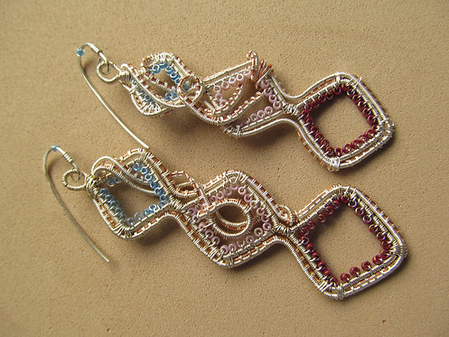 Handmade earrings of iridescent beaded wire wrap on silver and copper