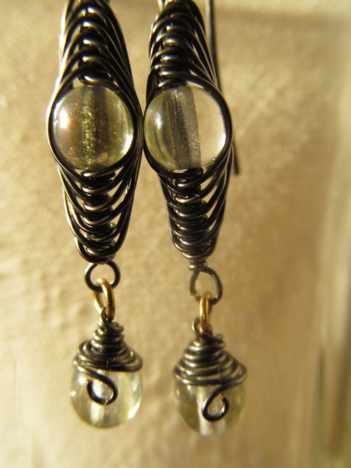 Handmade earrings of hematite wrapped copper glass