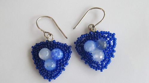 Handmade earrings of hand beaded blue glass and sterling silver ear wires