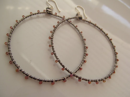 Handmade wrapped blush glass on hematite hoop earrings