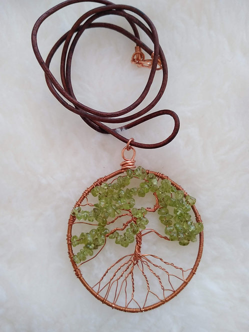 """copper 2.25"""" pendant with peridot chunks on 23"""" leather cord"""