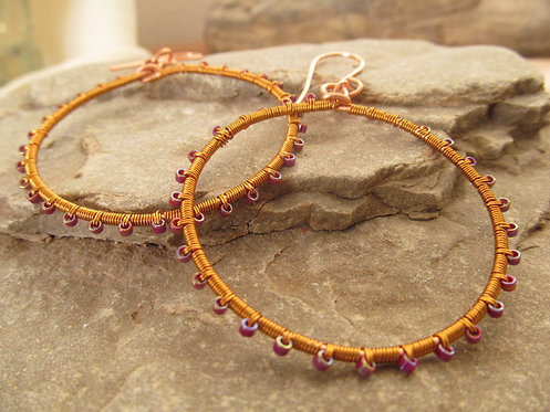 Handmade wrapped purple glass on copper hoop earrings