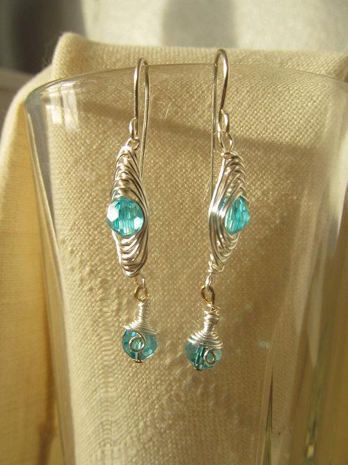 Handmade earrings of silver wrapped aqua glass