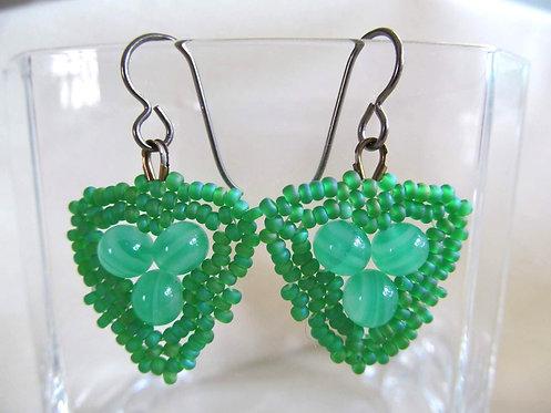 Handmade earrings of hand beaded matte grass green glass on titanium ear wires
