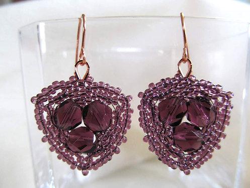 Handmade earrings of hand beaded lavender glass on copper ear wires