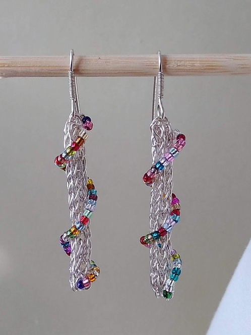 Handmade earrings of colored glass bead spiral on knitted silver