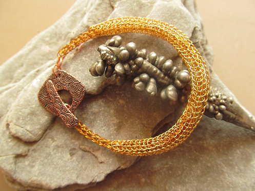 Handmade bracelet of knitted bronze and copper wires with embossed copper toggle
