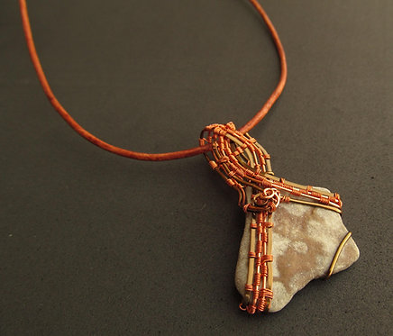 Handmade Necklace of smooth river stone on leather cord