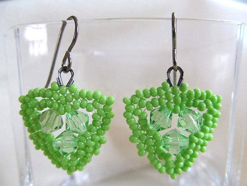 Handmade earrings of hand beaded matte spring green glass on titanium ear wires