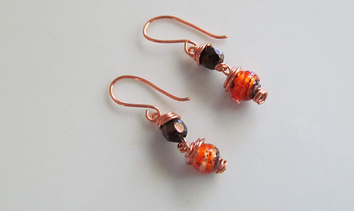 Handmade earrings drops of copper wire wrapped chocolate and orange glass