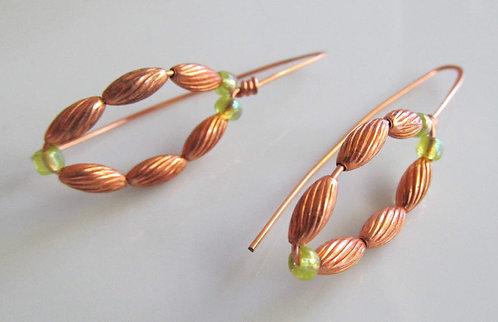 Handmade earrings threaders of light green glass on textured copper