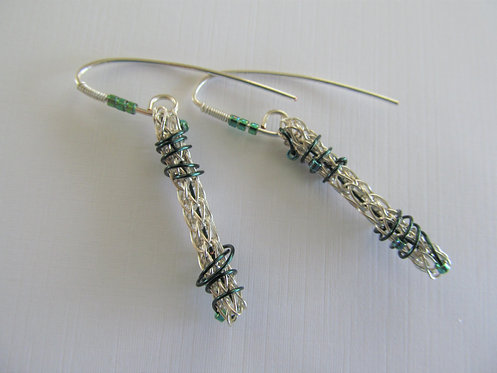 Handmade earrings of teal glass beads on knitted silver and teal wire