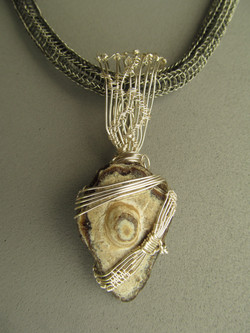silver wrapped chert on knitted gun metal