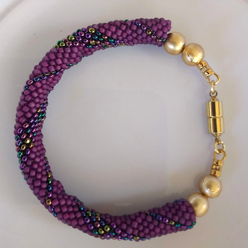 Handmade bracelet beaded in purple and blue iridescent glass with gold magnet
