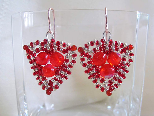 Handmade earrings of hand beaded red and silver glass on silver plated copper