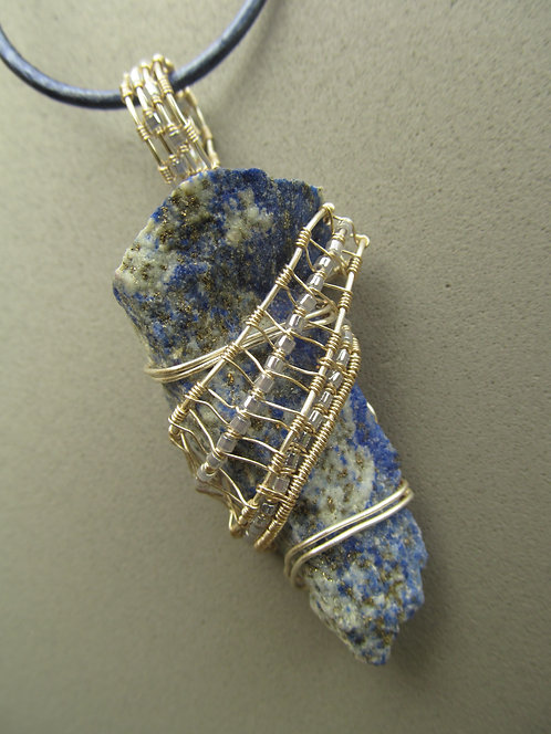 Handmade Necklace of raw lapis lazuli stone on blue-grey leather cord