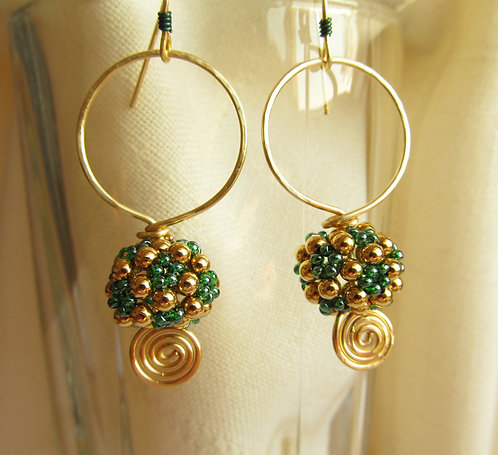 Handmade hoop earrings of teal green and gold ball on hoop with spiral