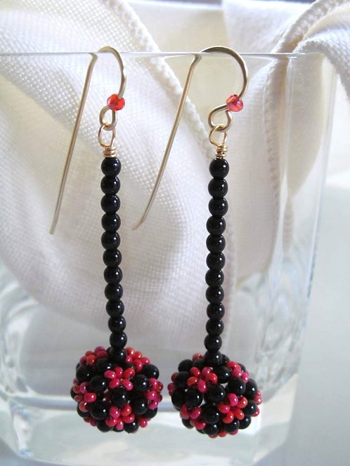 Handmade earrings of hand beaded Watermelon pink and black glass bead on gold