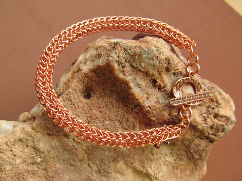 Handmade bracelet of knitted copper wire brass glass and embossed copper toggle
