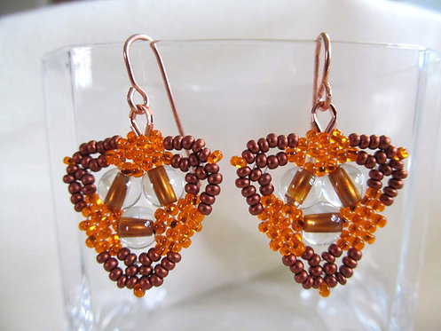 Handmade earrings of hand beaded butterscotch and copper glass on copper