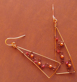 copper wired peach and coffee glass on triangle earrings