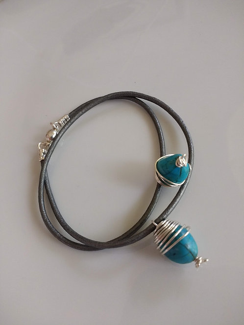 Handmade bracelet of wire wrapped turquoise beads on grey leather cord