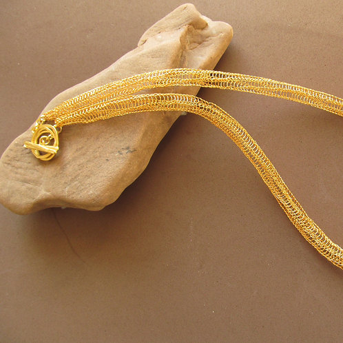 Handmade necklace of knitted gold