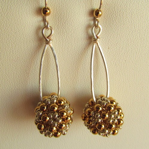 Handmade holiday earrings of silver and gold ball