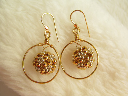 Handmade one-inch hoop earrings of hand beaded silver glass and gold plated bras