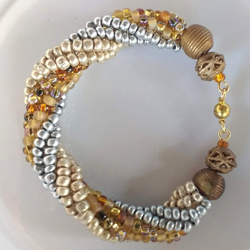 Handmade bracelet spiral of gold and silver glass with brass accents