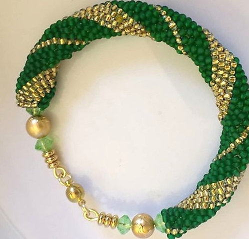 Handmade bracelet beaded in gold and green glass with gold magnetic clasp