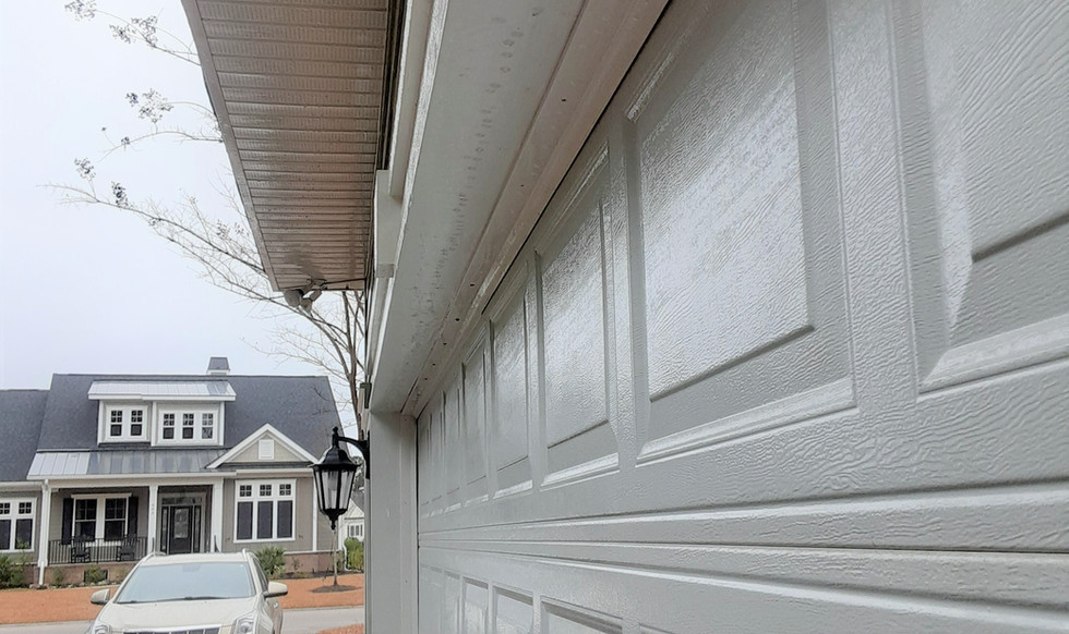 AFTER CLEANING SOFFIT AND GARAGE DOOR