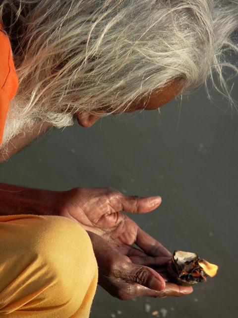 portrait of a hindu sadhu worship holy river narmada on heritage holy ghat of maheshwar in incredible india photography by nevil zaveri