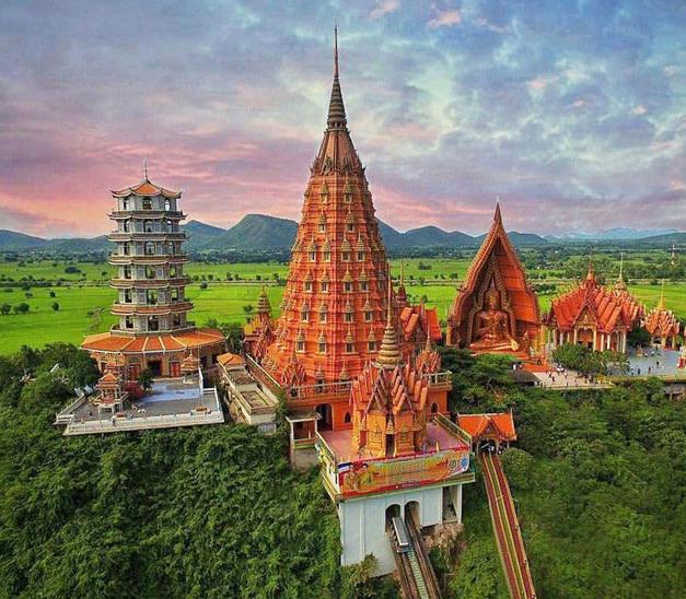 Make merit and admire the beauty of Wat Tham Seua temple...