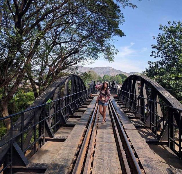 Walk over the famous River Kwai Bridge and explore Kanchanaburi town...