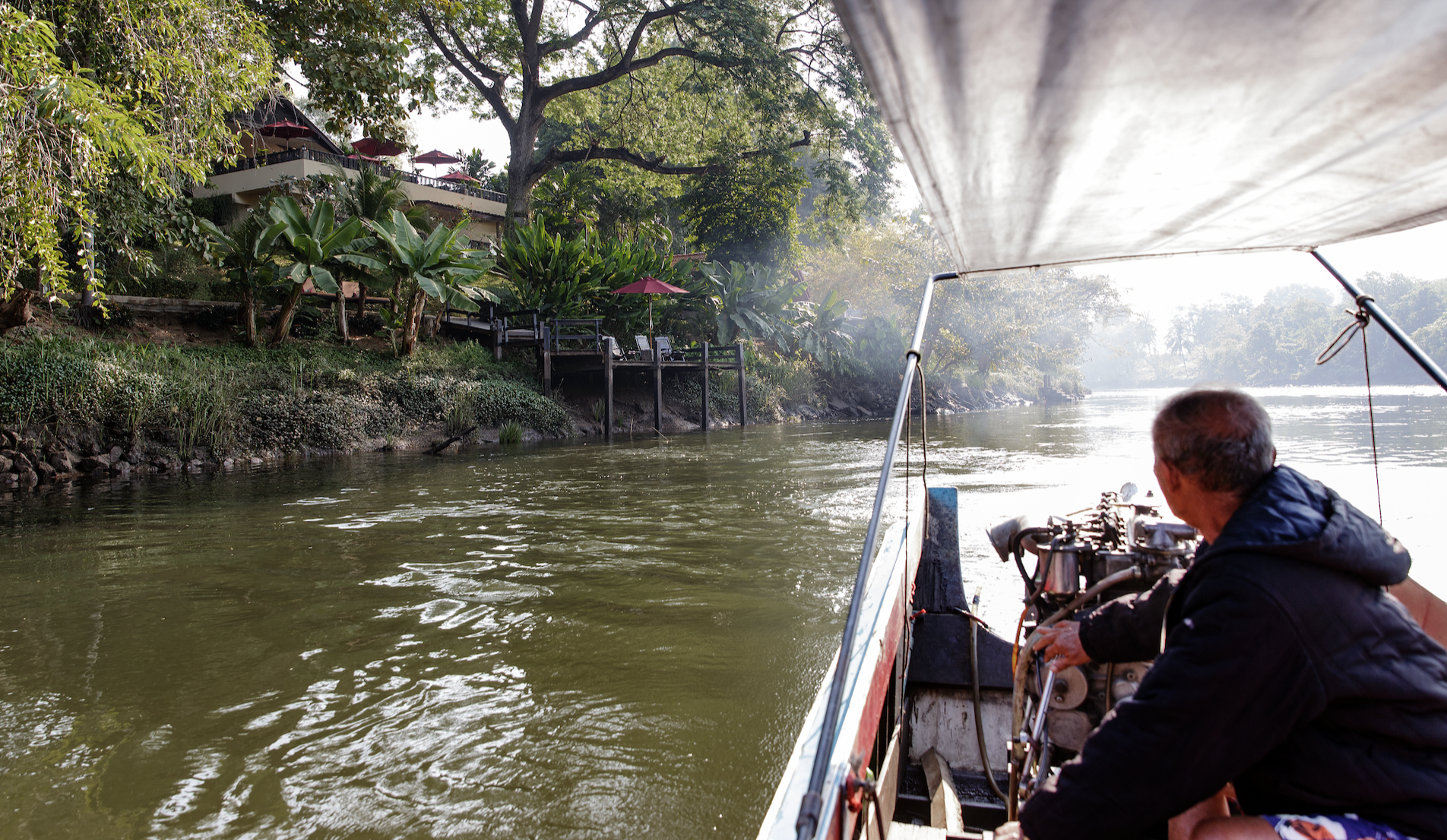 Long tail boat trip from Oriental Kwai to the river Kwai bridge Kanchanaburi