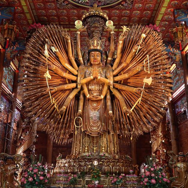 Admire the impressive wood carvings at Wat Metta Tham temple...