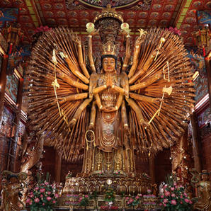 Admire the impressive wood carvings at Wat Metta Tham temple...
