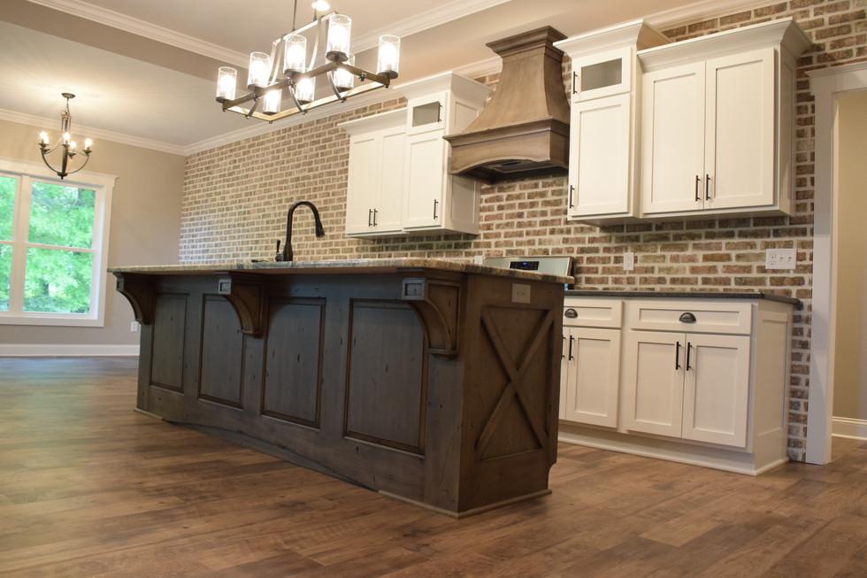 brick wall kitchen island custom cabinets
