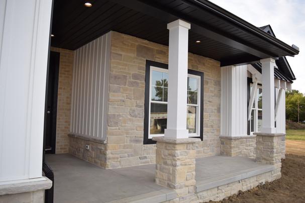 brick stone exterior craftsman style ranch home siding white