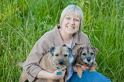 A picture of Dr. Pollock holding two of her own dogs