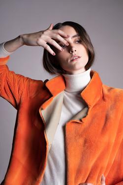 zoom abrigo naranja 1