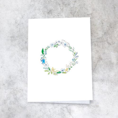 Blå blomsterkrans